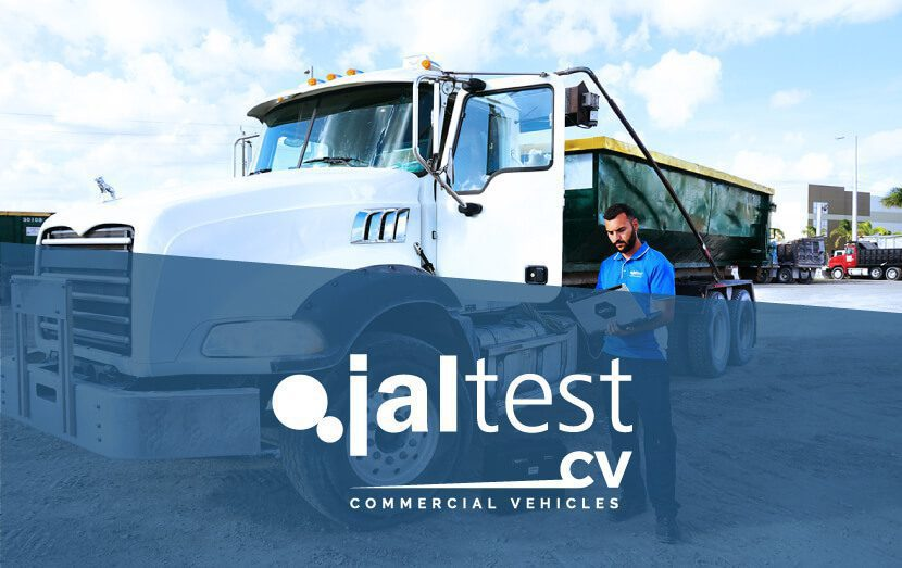 jaltest diagnostic specialist with computer next to commercial vehicle