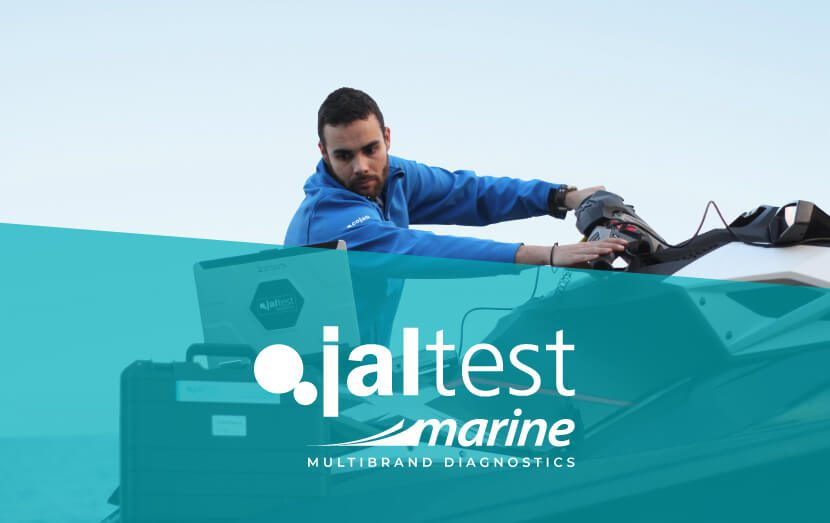 jaltest diagnostic specialist with computer next to marine vehicle