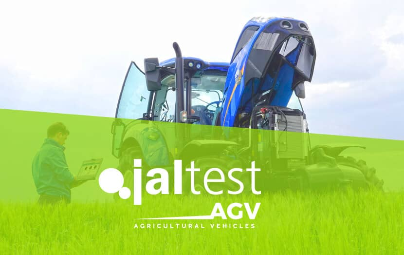 jaltest diagnostic specialist with computer next to agricultural vehicle