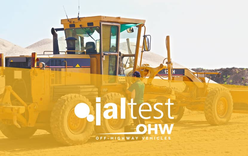 jaltest diagnostic specialist with computer next to off-highway vehicle