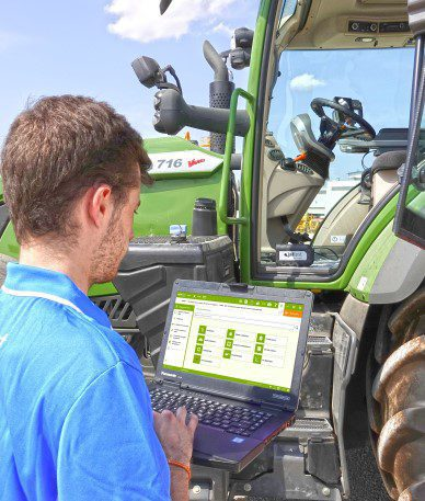man working on tractor with Jaltest